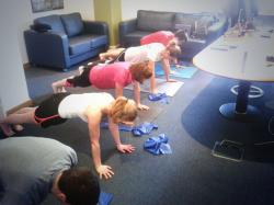 MCF Corporate Finance. Practicing Pilates in reception!